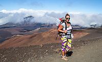 A backpacker pauses on the Sliding Sands Trail at Haleakala National Park on Maui.