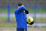 St Johnstone Training…<br />Michael O'Halloran pictured wiping his face during a very wet training session at McDiarmid Park ahead of Saturdays game against Motherwell.<br />Picture by Graeme Hart.<br />Copyright Perthshire Picture Agency<br />Tel: 01738 623350  Mobile: 07990 594431