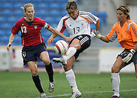 MAR 15, 2006: Faro, Portugal:  USWNT midfielder (13) Kristine Lilly tries to get to the ball as German defender (13) Sandra Minnert clears it in the finals of the Algarve Cup in Faro, Portugal.