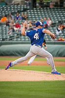 Eric Surkamp (41) the starting pitcher of the Oklahoma City Dodgers delivers a pitch to the plate against the Salt Lake Bees in Pacific Coast League action at Smith's Ballpark on May 27, 2015 in Salt Lake City, Utah.  (Stephen Smith/Four Seam Images)