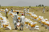 Food aid arrives at the Swabi Refugee camp. The camp is run by Red Cross/Red Crescent (ICRC), and currently houses around 18,000 refugees. The Pakistani government began an offensive against the Taliban in the Swat Valley in April 2009, which led to a major humanitarian crisis. Up to two million civilians were estimated to have been displaced by the fighting.