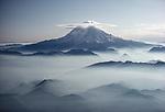 Lenticular clouds crown Mt. Rainier, Mt. Rainier National Park, Washington, USA