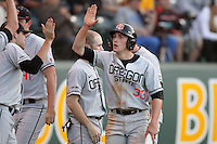 Ryan Barnes #33 of the Oregon State Beavers is greeted by teammates after scoring  against the UCLA Bruins at Jackie Robinson Stadium in Los Angeles,California on April 29, 2011. Photo by Larry Goren/Four Seam Images