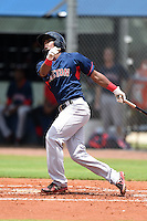 GCL Red Sox outfielder Joseph Monge (25) hits his first professional home run during a game against the GCL Rays on June 24, 2014 at Charlotte Sports Park in Port Charlotte, Florida.  GCL Red Sox defeated the GCL Rays 5-3.  (Mike Janes/Four Seam Images)