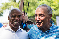 """NEW YORK, NEW YORK - JULY 7: Democratic New York City mayoral candidate Eric Adams (left) and Senate Majority Leader Chuck Schumer attend the Ticker Tape Parade """"Heroes of the hometown """"on July 7, 2021 in New York City. Healthcare workers, first responders and essential workers are honored at the Canyon of Heroes in Manhattan for their service during the COVID-19 pandemic. (Photo by Pablo Monsalve / VIEWpress via Getty Images)"""
