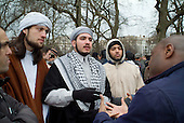 Christian converts to Islam argue with two Christians at Speakers' Corner in Hyde Park, London.