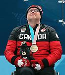 Dennis Thiessen, PyeongChang 2018 - Wheelchair Curling // Curling en fauteuil roulant.<br /> Dennis Thiessen receives the bronze medal // Dennis Thiessen reçoit la médaille de bronze. 17/03/2018.