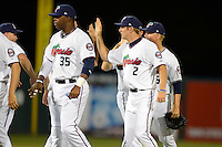 Fort Myers Miracle first baseman Kennys Vargas #35 and outfielder Mike Kvasnicka #2 high five teammates after a game against the Jupiter Hammerheads on April 9, 2013 at Hammond Stadium in Fort Myers, Florida.  Fort Myers defeated Jupiter 1-0.  (Mike Janes/Four Seam Images)