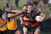 Leroy Jack fends off Vilitati Sabani as he makes a strong run upfield. Counties Manukau Premier Club rugby game between Te Kauwhata and Onewhero, played at Te Kauwhata on Saturday April 16th 2016. Onewhero won the game 37 - 0 after leading 13 - 0 at Halftime. Photo by Richard Spranger.