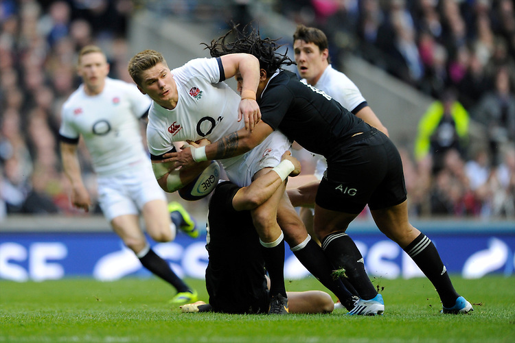 Owen Farrell of England is tackled by Ma'a Nonu of New Zealand during the QBE Autumn International match between England and New Zealand at Twickenham on Saturday 16th November 2013 (Photo by Rob Munro)