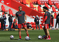 24th April 2021; Anfield, Liverpool, Merseyside, England; English Premier League Football, Liverpool versus Newcastle United; Thiago Alcantara of Liverpool speaks with team mate Mohammed Salah of Liverpool during the pre match warm up