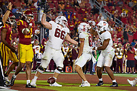 LOS ANGELES, CA - SEPTEMBER 11: Branson Bragg #66 and Elijah Higgins #6 celebrate with Brycen Tremayne #81 of the Stanford Cardinal after his touchdown reception during a game between University of Southern California and Stanford Football at Los Angeles Memorial Coliseum on September 11, 2021 in Los Angeles, California.