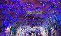 """30/11/15<br /> <br /> Ava Hodgson, and her dad Daniel, marvel at the amazing decorations in the 'Indoor Igloo'.<br /> <br /> It has taken a team of five, two weeks to put up this stunning display of Christmas decorations in what is believed to be one of Britain's most festive pubs. The race was on to put up the 7,500 baubles and 27,000 fairy lights, before guests arrived for the pub's first Christmas parties held last night . <br /> <br /> Each of the five rooms at the Hanging Gate at Chapel-en-le-Frith in the Derbyshire Peak District has a different theme or colour. This year the main restaurant is the Indoor Igloo, the bar area is purple and gold and there's the Candy Cain room upstairs in the pub near Buxton. There's also has another 10,000 lights on the outside of the building. <br /> <br /> """"We've had to replace a few thousand of the LED lights this year, I buy them in huge lengths so it's cost lots  to get everything ready"""" said landlord Mark Thomas.<br /> <br /> All Rights Reserved: F Stop Press Ltd. +44(0)1335 418365   www.fstoppress.com."""