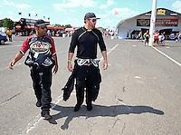 Jun. 2, 2013; Englishtown, NJ, USA: NHRA top fuel dragster driver Khalid Albalooshi (left) walks with Shawn Langdon during the Summer Nationals at Raceway Park. Mandatory Credit: Mark J. Rebilas-