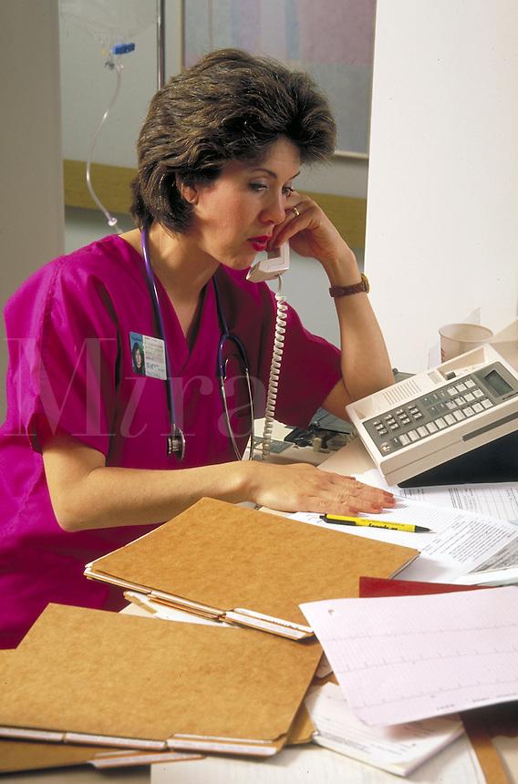 Nurse at hospital nursing station