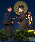 May 18, 2014; Former hockey player Joe Rogers receives his diploma from Mendoza College of Business dean Roger Huang at the 2014 Commencement ceremony.<br /> <br /> Photo by Matt Cashore/University of Notre Dame