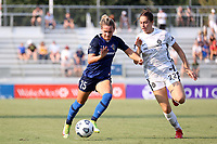 CARY, NC - SEPTEMBER 12: Meredith Speck #25 of the North Carolina Courage is chased by Morgan Weaver #22 of the Portland Thorns FC during a game between Portland Thorns FC and North Carolina Courage at Sahlen's Stadium at WakeMed Soccer Park on September 12, 2021 in Cary, North Carolina.