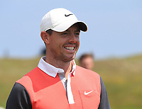 13th July 2021; The Royal St. George's Golf Club, Sandwich, Kent, England; The 149th Open Golf Championship, practice day; Rory McIlroy (NIR) smiles as he speaks with local school children at the 8th hole