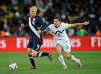 Michael Bradley (4) of USA and Robert Koren (8) of Slovenia. USA tied Slovenia 2-2 in the 2010 FIFA World Cup at Ellis Park in Johannesburg, South Africa on June 18th, 2010.