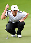 TAIPEI, TAIWAN - NOVEMBER 20:  Lorens Chan of USA lines up a putt on the 1st green during day three of the Fubon Senior Open at Miramar Golf & Country Club on November 20, 2011 in Taipei, Taiwan. Photo by Victor Fraile / The Power of Sport Images