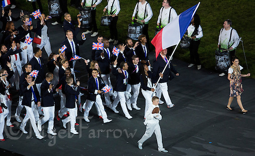 27 JUL 2012 - LONDON, GBR - Fencing competitor Laura Flessel-Colovic leads the team from France into the Olympic Stadium during the Opening Ceremony of the London 2012 Olympic Games in Stratford, London, Great Britain (PHOTO (C) 2012 NIGEL FARROW)
