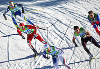 USA's Andrew Newell (13) navigates traffic while descending a hill in the men's team sprint freestyle final at the XXI Olympic Winter Games Monday, February 22, 2010 at Whistler Olympic Park in Whistler, British Columbia.