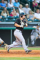 Brian Holberton (10) \oqc\ follows through on his swing against the Bowling Green Hot Rods at Bowling Green Ballpark on July 26, 2014 in Bowling Green, Kentucky.  The River Bandits defeated the Hot Rods 9-2.  (Brian Westerholt/Four Seam Images)
