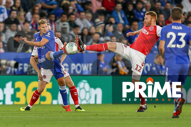 Marc Albrighton of Leicester City and Cian Bolger of Fleetwood Town during the English League Cup Round 2 Group North match between Leicester City and Fleetwood Town at the King Power Stadium, Leicester, England on 28 August 2018. Photo by David Horn.