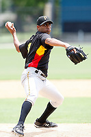 """July 13, 2009:  Pitcher Rinku Singh of the GCL Pirates delivers a pitch during a game at Tiger Town in Lakeland, FL.  Singh faced one batter, a strike out, to earn the first win for a pitcher from India.  Singh along with Dinesh Patel were signed out of India through the contest """"The Million Dollar Arm"""".  The GCL Pirates are the Gulf Coast Rookie League affiliate of the Pittsburgh Pirates.  Photo By Mike Janes/Four Seam Images"""