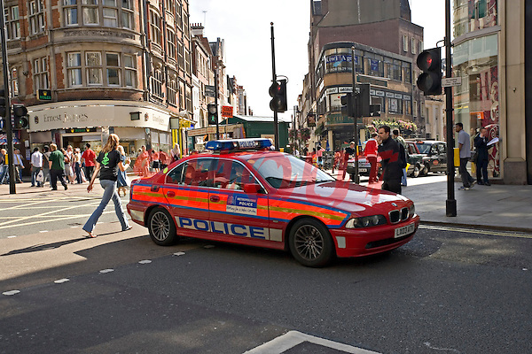 Met Police Diplomatic Protection Group CO6 red BMW series 5 Police car in Oxford Street London UK. This image may only be used to portray the subject in a positive manner..©shoutpictures.com..john@shoutpictures.com