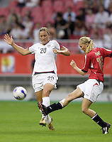 USA forward (20) Abby Wambach and Norway defender (19) Marit Fiane Christensen. The United States (USA) defeated Norway (NOR) 4-1 during the third place match of the Women's World Cup China 2007 at Shanghai Hongkou Football Stadium, Shanghai, China, on September 30, 2007.