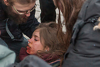 Protesters help a young woman injured after being hit at close range by tear gas shot by a policeman during a protest against austerity organized by the ASSE student group in Quebec city Thursday March 26, 2015.<br /> <br /> PHOTO :  Francis Vachon - Agence Quebec Presse