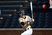 Patrick Frick (5) of the Wake Forest Demon Deacons follows through on his swing against the Virginia Cavaliers at David F. Couch Ballpark on May 19, 2018 in  Winston-Salem, North Carolina. The Demon Deacons defeated the Cavaliers 18-12. (Brian Westerholt/Four Seam Images)