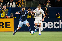 CARSON, CA - MARCH 07: Ali Adnan #53 of Vancouver Whitecaps battles Rolf Feltscher #25 of the Los Angeles Galaxy during a game between Vancouver Whitecaps and Los Angeles Galaxy at Dignity Health Sports Park on March 07, 2020 in Carson, California.