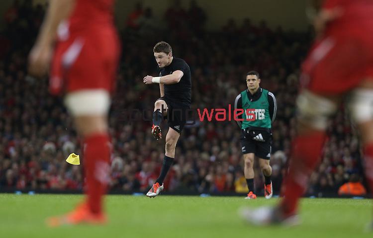All Black outside half Beauden Barrett kicks a penalty as Dan Carter looks on.<br /> Dove men Series 2014<br /> Wales v New Zealand<br /> 22.11.14<br /> ©Steve Pope -SPORTINGWALES