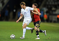 Jonathan Spector of USA and Juan Manuel Mata of Spain. USA defeated Spain 2-0 during the semi-finals of the FIFA Confederations Cup at Free State Stadium in Manguang/Bloemfontein, South Africa on June 24, 2009..