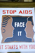 "Lolgorian, Kenya. Public health AIDS poster; ""Stop AIDS Face It It Starts With You""."