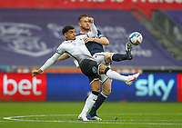 3rd October 2020; Liberty Stadium, Swansea, Glamorgan, Wales; English Football League Championship, Swansea City versus Millwall; Morgan Gibbs-White of Swansea City and Alex Pearce of Millwall challenge for the ball