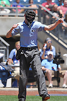 Home plate umpire Kyle McCrady calls a third strike during a game between the Tulsa Drillers and the Arkansas Travelers at Oneok Field on May 21, 2017 in Tulsa, Oklahoma.  The Drillers won 13-6. (Dennis Hubbard/Four Seam Images)