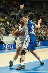 Real Madrid´s Gustavo Ayon and Anadolu Efes´s Dario Saric during 2014-15 Euroleague Basketball match between Real Madrid and Anadolu Efes at Palacio de los Deportes stadium in Madrid, Spain. December 18, 2014. (ALTERPHOTOS/Luis Fernandez)