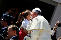 Papa Francesco saluta una bambina al suo arrivo all'udienza generale del mercoledi' in Piazza San Pietro, Citta' del Vaticano, 23 aprile 2014.<br /> Pope Francis greets a child as he arrives to attend his weekly general audience in St. Peter's Square at the Vatican, 23 April 2014.<br /> UPDATE IMAGES PRESS/Isabella Bonotto<br /> <br /> STRICTLY ONLY FOR EDITORIAL USE