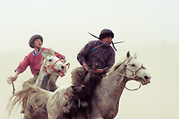 "The most famous Kyrgyz horse game is ""Kok boru"", also known as ""Ulak Tartysh"". The game is played with two teams of up to 12 people, who take their positions on opposite sides of a field.  The goal is to to ""grab"" a goat carcass and carry it into the ""gate"" of the enemy within the allotted time"