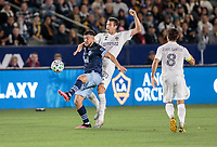 CARSON, CA - MARCH 07: Lucas Cavallini #9 of the Vancouver Whitecaps battles Nick DePuy #20 of the Los Angeles Galaxy during a game between Vancouver Whitecaps and Los Angeles Galaxy at Dignity Health Sports Park on March 07, 2020 in Carson, California.