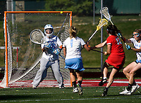 Logan Ripley (48) of North Carolina looks to make a save on the shot of Shannon McHugh (12) of Cornell at St. Stephens and St. Agnes High School in Alexandria, VA.  North Carolina defeated Cornell, 13-7.