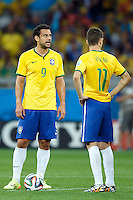 Fred and Oscar of Brazil look dejected