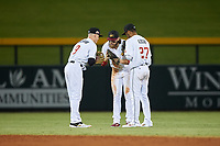 Mesa Solar Sox outfielders Greg Deichmann (9), Brandon Marsh (4), and Jose Azocar (27) celebrate a victory after an Arizona Fall League game against the Peoria Javelinas on September 21, 2019 at Sloan Park in Mesa, Arizona. Mesa defeated Peoria 4-1. (Zachary Lucy/Four Seam Images)