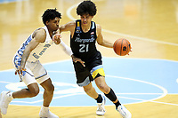 CHAPEL HILL, NC - FEBRUARY 24: D.J. Carton #21 of Marquette drives against Caleb Love #2 of North Carolina during a game between Marquette and North Carolina at Dean E. Smith Center on February 24, 2021 in Chapel Hill, North Carolina.