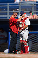 Auburn Doubledays catcher Tres Barrera (15) gets looked at by trainer Darren Yoos during a game against the Batavia Muckdogs on September 5, 2016 at Dwyer Stadium in Batavia, New York.  Batavia defeated Auburn 4-3. (Mike Janes/Four Seam Images)