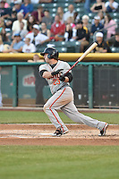 Mark Minicozzi (23) of the Fresno Grizzlies at bat against the Salt Lake Bees at Smith's Ballpark on May 25, 2014 in Salt Lake City, Utah.  (Stephen Smith/Four Seam Images)
