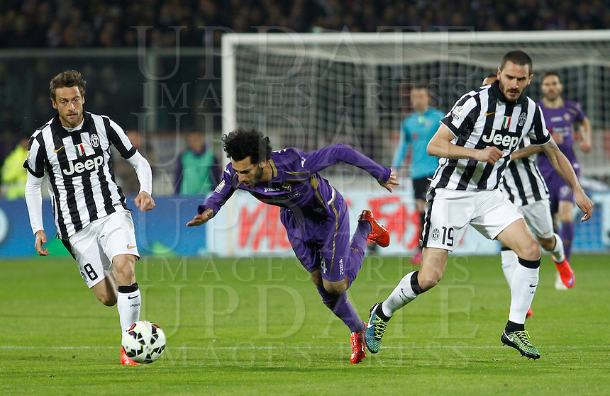 Calcio, Coppa Italia: semifinale di ritorno Fiorentina vs Juventus. Firenze, stadio Artemio Franchi, 7 aprile 2015. <br /> Fiorentina's Mohamed Salah, center, is fouled by Juventus' Giorgio Chiellini during the Italian Cup semifinal second leg football match between Fiorentina and Juventus at Florence's Artemio Franchi stadium, 7 April 2015. At left, Juventus' Claudio Marchisio.<br /> UPDATE IMAGES PRESS/Isabella Bonotto